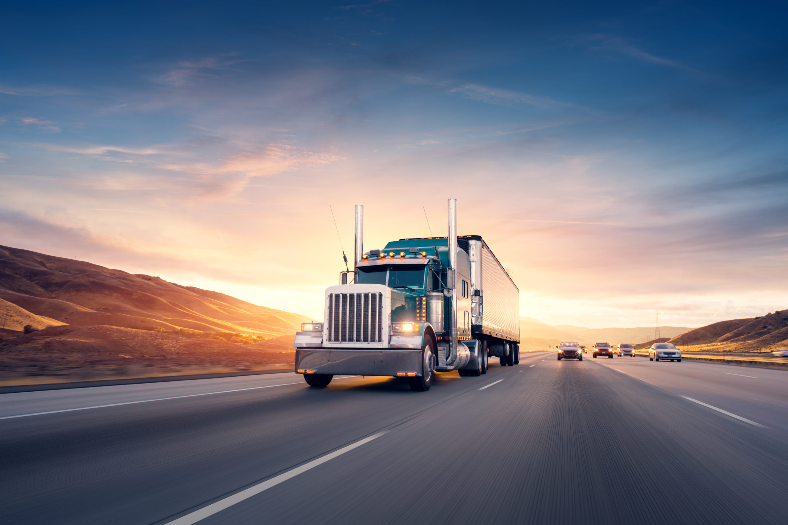 Blog - American style truck on freeway pulling load. Transportation the